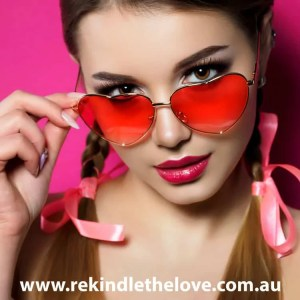 woman looking over heart shaped and rose tinted glasses
