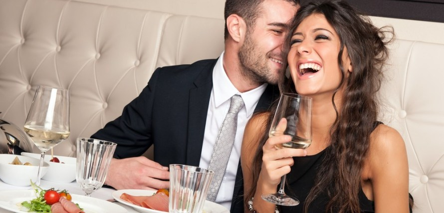 Man and woman on a date thinking about sex. The woman is holding a glass with wine in it.