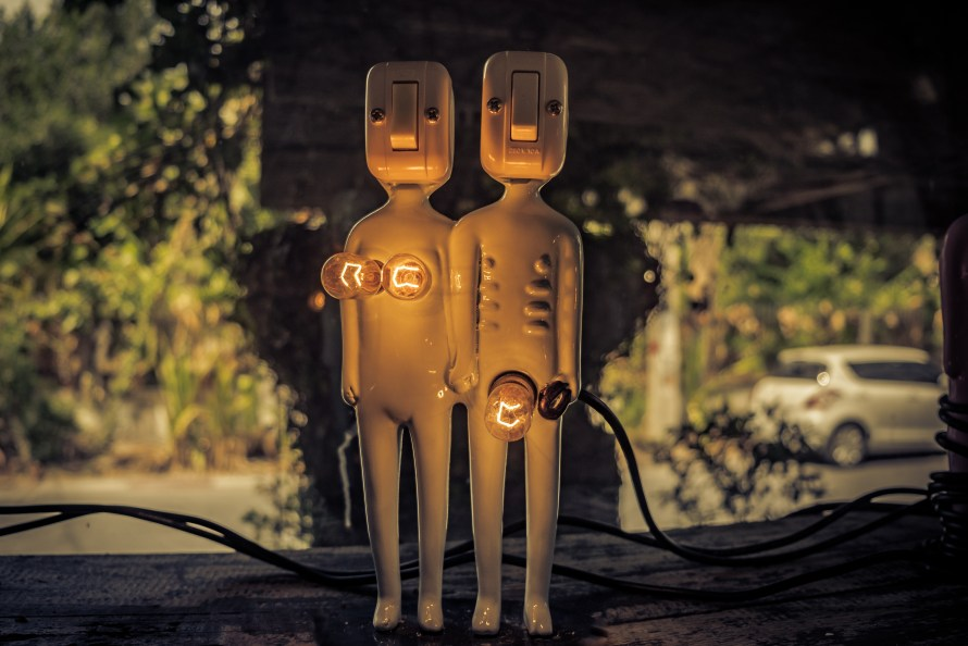 a dating amber-colored man and woman lamp