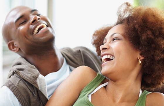 Man-and-woman-laughing-misconception-women-have-for-mens-needs