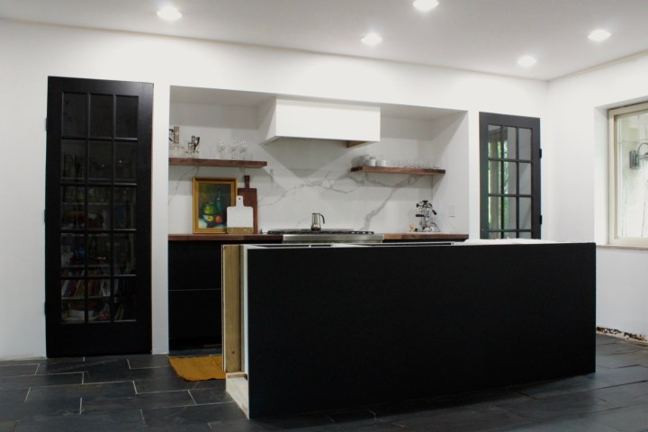 marble backsplash, Superiore range, black walnut butcher block black kitchen modern kitchen