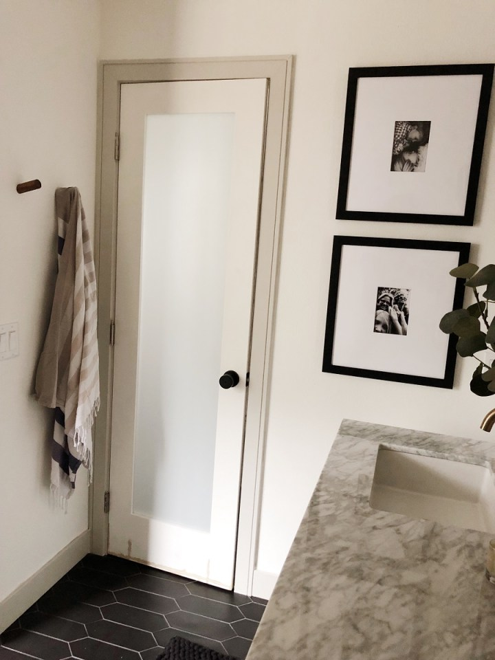 "Black picket ceramic floor tile. 72"" white marble vanity. Black Accents, frame it easy photography. Turkish towel, walnut towel hooks."