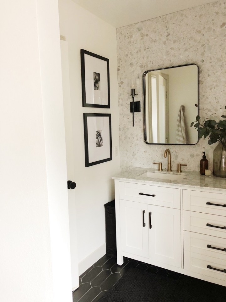 "72"" Bathroom vanity with two rounded mirrors. Black and gold accents used throughout. Floor to ceiling Terrazo Tile Backsplash. Frames by Frame it Easy."