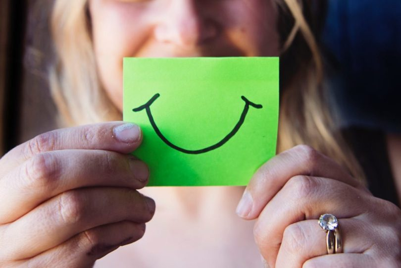 Smile with a positive emotion
