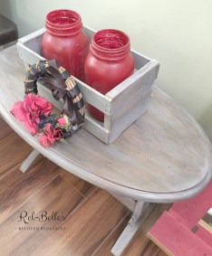 The top of the oval rustic side table