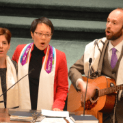 two women, rabbis, and a man holding a guitar