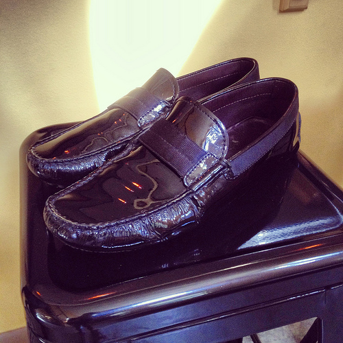 Beloved and well-loved pair of Tod's patent gommino drivers