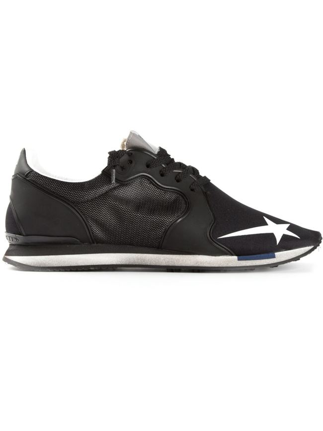 Golden Goose black low-profile trainers, at Farfetch