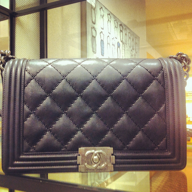 An example of Chanel's Le Boy handbag, in black lambskin with aged hardware