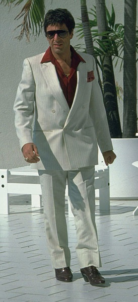 Al Pacino in Scarface, wearing a double-breasted white suit