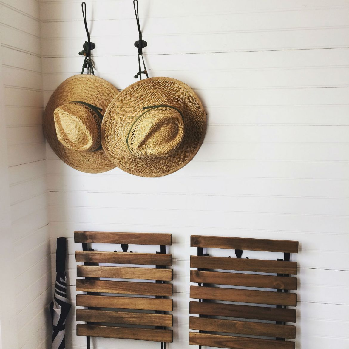 Coat hooks, straw hats, and foldable chairs in Ybor City's newest tiny house