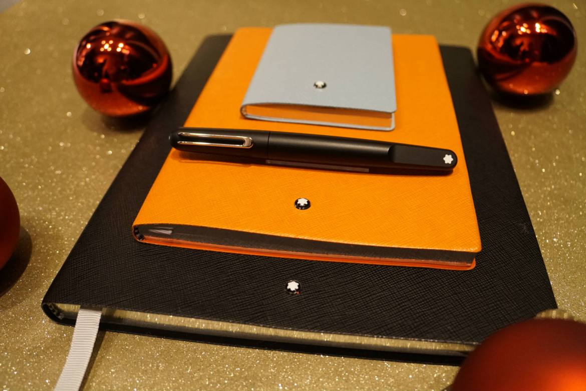 Montblanc M rollerball pen with stationery notebooks in mint, lucky orange, and black