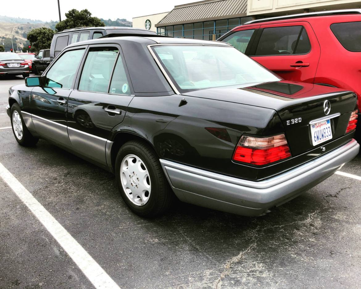 1994 or 1995 (post-facelift) W124 Mercedes E320 sedan in black over gray. SWOON!