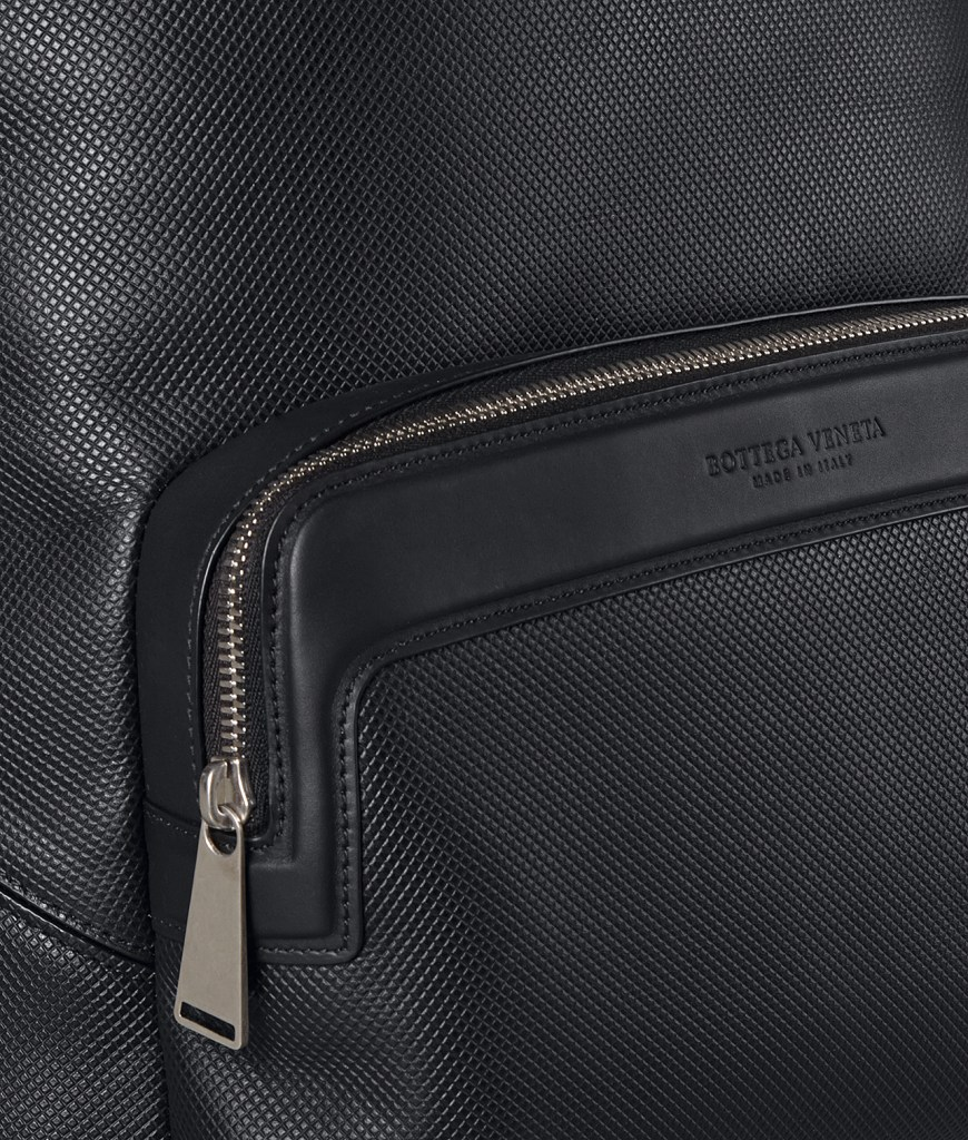 Shiny zipper pull on Bottega Veneta backpack