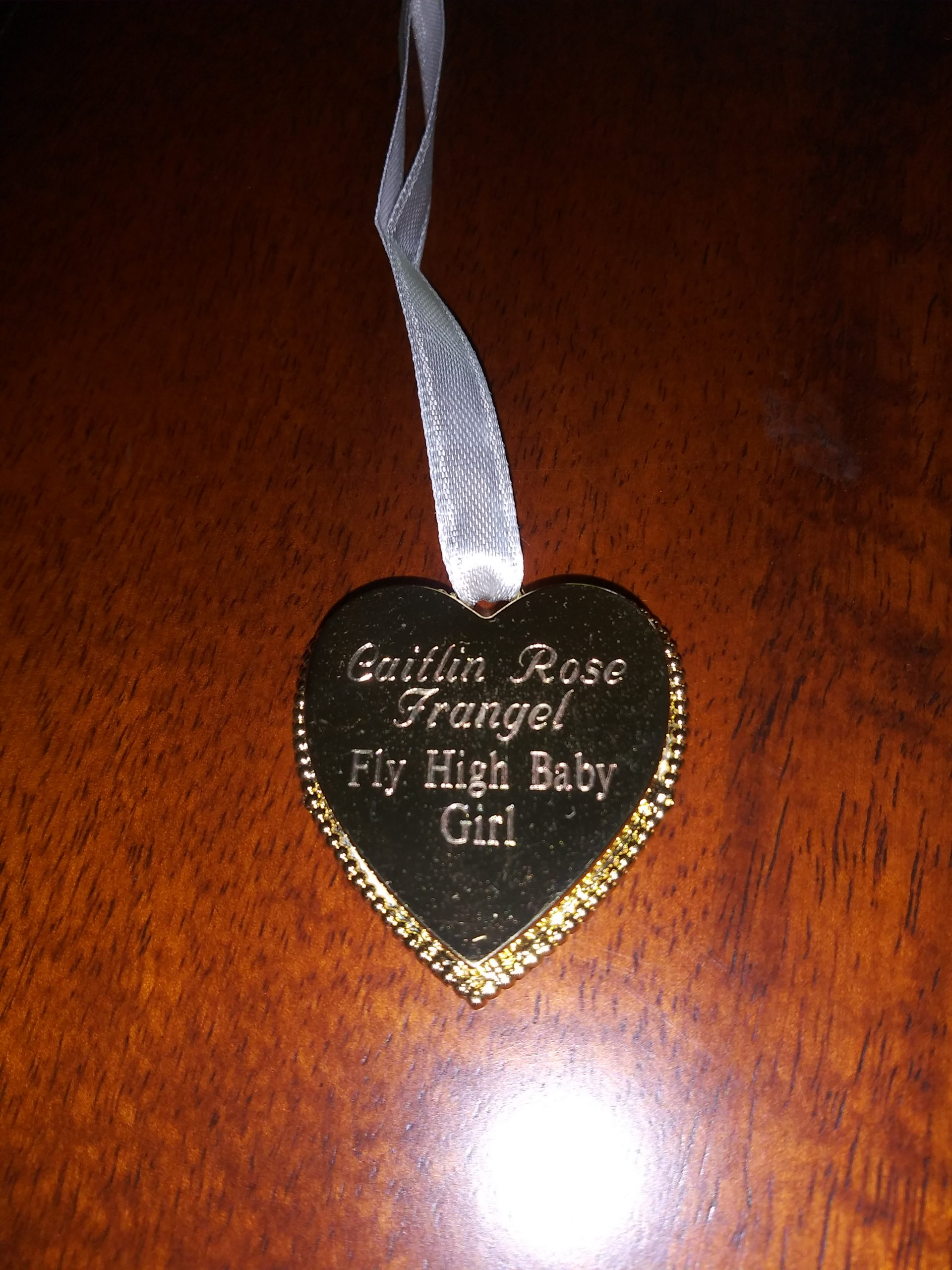 """Caitlin Frangel's pendant reverse side - Caitlin Rose Frangel """"Fly High baby girl"""""""