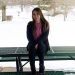 Caitlin Frangel sitting on bench