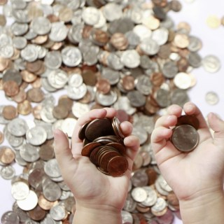Coins In Child Hands