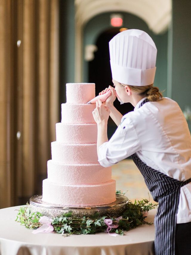 The cake table is often a main focal point of the reception space where many of your guests will congregate to take pictures. It's also going to be the center of attention for your cake-cutting photos, so you'll want to set that stage perfectly.
