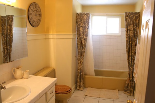 Yellow tub and toilet updated yellow and grey bathroom