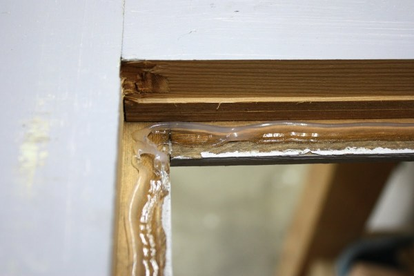 12 Silicone used to secure glass panels in door remodel by Its the Little Things featured on @Remodelaholic