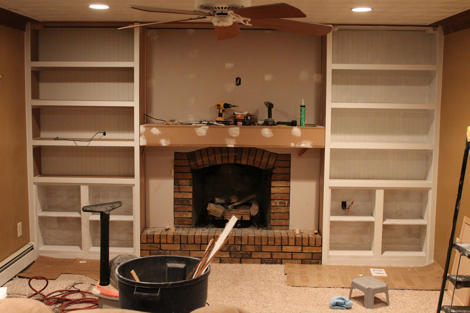Elegant Fireplace Makeover With Builtins Made From Stock Cabinetry (1)