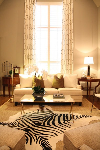 Designing-A-Living-Room-With-Tall-Walls-zebra-pattern-dyed-cow-hide (8)