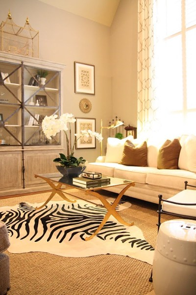 Designing-A-Living-Room-With-Tall-Walls-zebra-pattern-dyed-cow-hide
