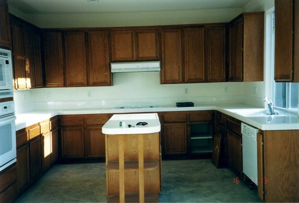 2 Oak cabinets to white, kitchen remodel, by My Uncommon Slice of Suburbia featured on @Remodelaholic