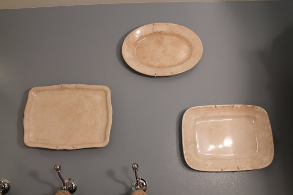 18 Ironstone platters on the wall, by Elizabeth and Co featured on @Remodelaholic