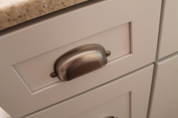 9 Bathroom drawer pulls, Delta from Home Depot kitchen dept, by Elizabeth and Co featured on @Remodelaholic