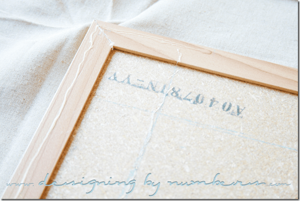 Apply glue on the back of the corkboard and on the back of the frame