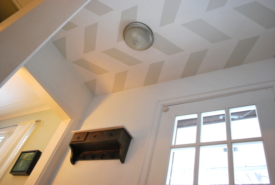 9 Simple herringbone pattern painted on the ceiling completely transforms the feel of this home's entryway, by The Sweetest Digs featured on @Remodelaholic