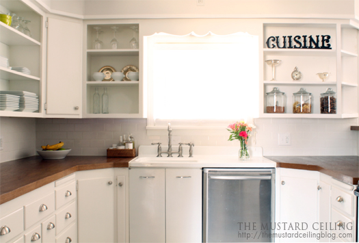 finished kitchen with solid wood doors repurposed into countertops, The Mustard Ceiling on @Remodelaholic