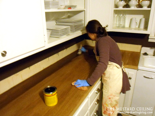 staining DIY upcycled wood door countertops, The Mustard Ceiling on @Remodelaholic