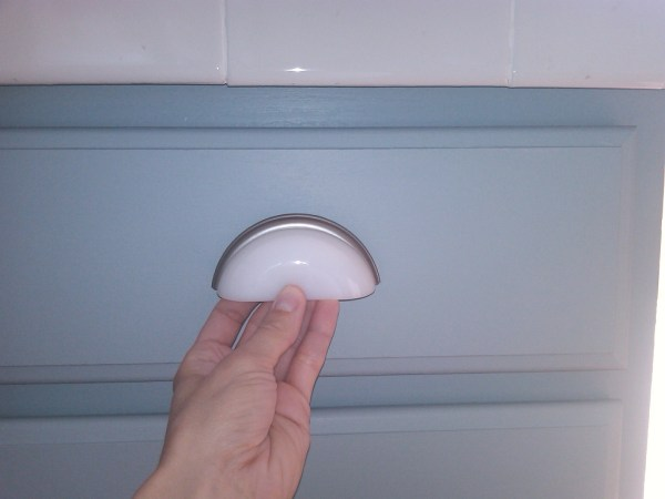 7 White drawer pulls for gray painted cabinets, Mom and Her Drill featured on @Remodelaholic