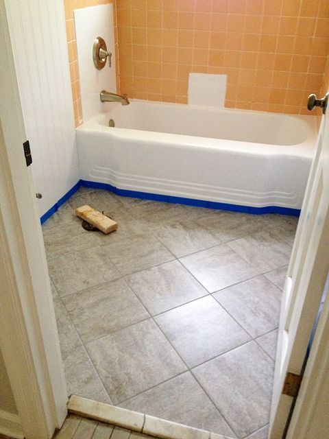 Remodelaholic Bathroom Redo Grouted Peel and Stick Floor Tiles