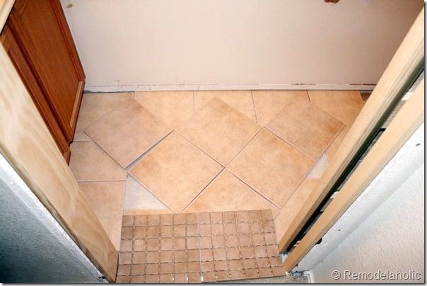 remodelaholic inlaid tile rug tutorial