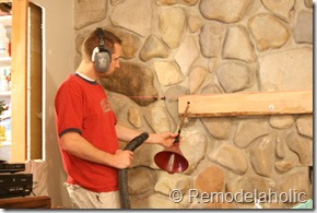Installing a wood mantel on a stone wall (34)