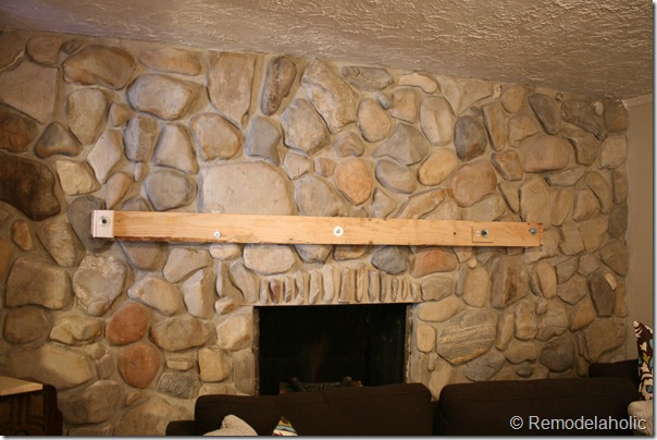 Installing a wood mantel on a stone wall (58)