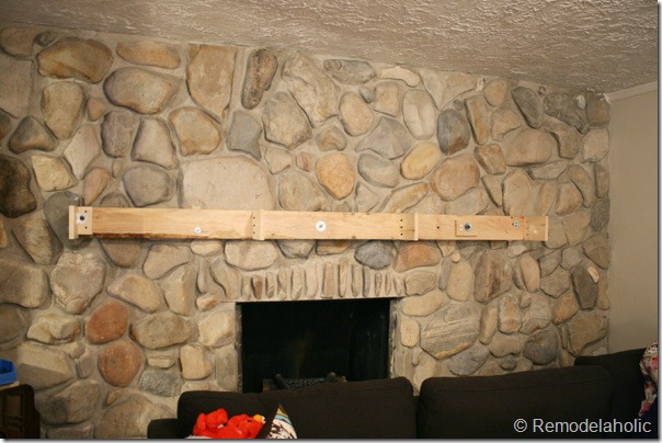 Installing a wood mantel on a stone wall (60)