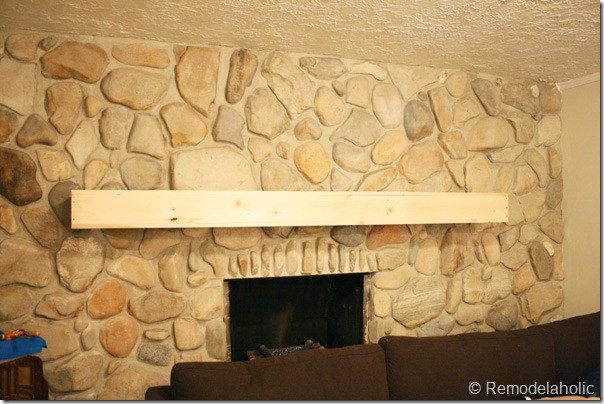 Installing a wood mantel on a stone wall (75)