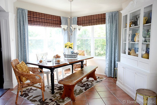 Dining Room updates bamboo shades-bench-wicker chairs white hutch blue and yellow (2)
