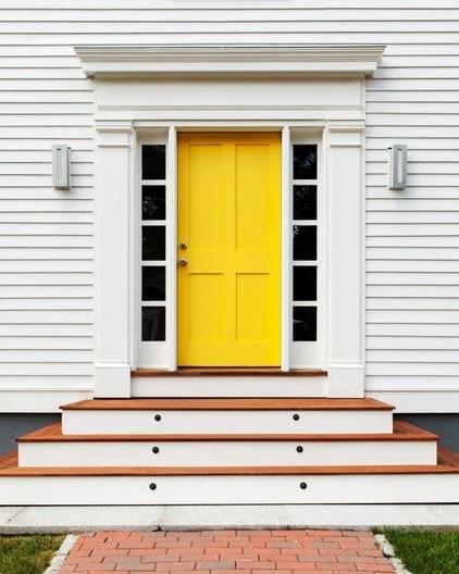 Yellow Entry door on white exterior