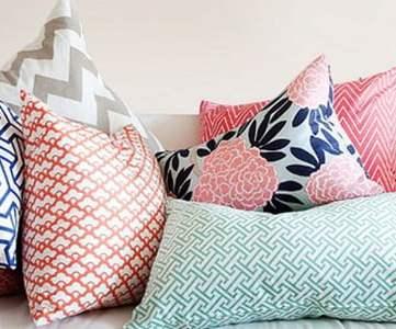 pink and navy throw pillow