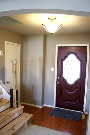 Entry updates black door white moldings entry table columns (16)