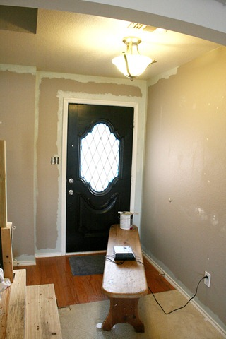 Entry updates black door white moldings entry table columns (25)