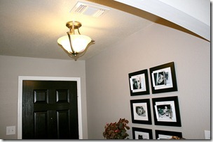 Entry updates black door white moldings entry table columns (8)