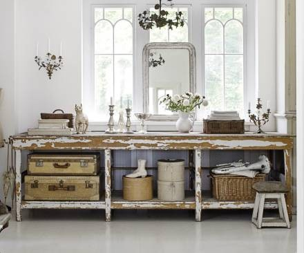 vintage suticases for storage on console table