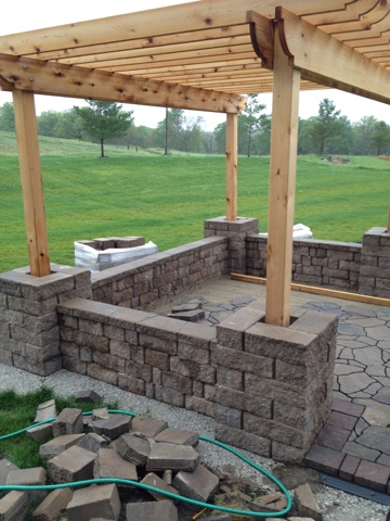 build a patio with a pergola and seat wall
