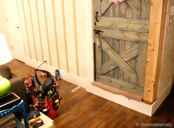 building out stair with wood bullnose and house numbers under barn door (3)